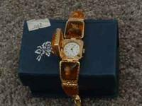 This is a Watch Bracelet with amber-like settings, $15,