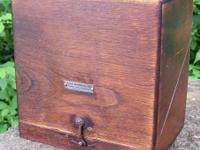 Hinged wooden box with bakelite inserts for holding a