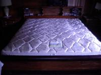 very nice shape water bed with soild wood bed frame,