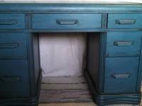 Wood desk, painted teal with dark glaze finish. Has a