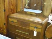 This is a beautiful Waterfall Dresser includes a