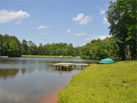 An unusual find, this 64.94 Acre home is zoned for a