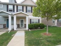 Immaculate two story townhome in Waukee is sure to