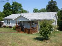 THIS BEAUTIFULLY WELL MAINTAINED DOUBLEWIDE HAS MANY