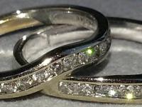 2 Beautiful diamond bands, curved on either side of