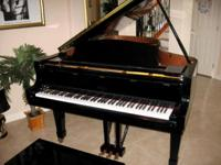 You must see and play this 2002 grand piano if you are