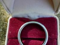 Men's size 10 titanium wedding band.  Good condition.
