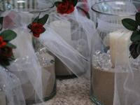 We made these for a Rehearsal dinner. Glass vases with