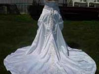 Wedding dress, never been used. Strapless, corset style