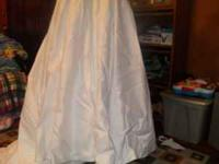 LOVE + CHERISH WEDDING DRESS. WORN ONCE. BETWEEN SIZE