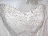 This wedding dress is a beautiful Ivory with beaded