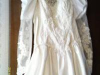 I have a beautiful wedding dress for sale. I wore it 20