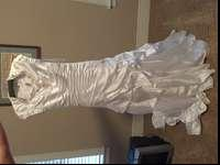 White wedding gown. Size 4. Used once. Beautiful