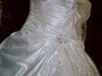 This is a wedding gown by maggie sottero, diamond