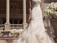 Casablanca 2107 is a gorgeous mermaid wedding dress.