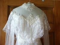 Old fashioned wedding dress for sale.  Size 12.  Train