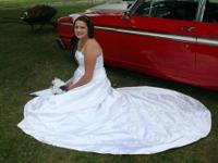 I m looking to sell my wedding dress. It is size 14 and