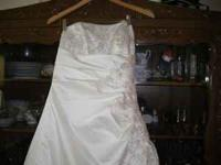 Size 10 Ivory Wedding Dress from David's Bridal. Price