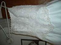 Size 6 white wedding dress with beaded design on top