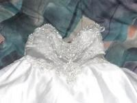 Marys Bridal size 10. Has a small stain on bottom, but