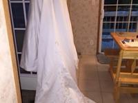 Beautiful wedding gown worn once. Size 4 beautiful