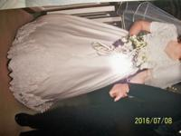 Have a wedding gown for sale. Mid-size train that can