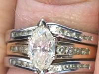 Center .92 marquise with .16 channel diamonds 14 kt