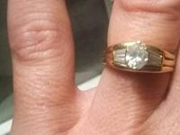 This is a ladies 14K gold engagement ring with a .77ct.
