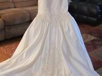 This beautiful soft cream white satin wedding gown has