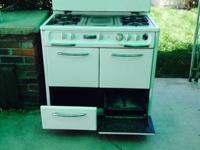 "40"" Wedgewood Stove Model # T8148GT. Has 4 burners,"