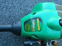 This is a Weed Eater Featherlite SST25. It takes a