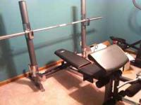 Almost new Weight Bench. Sells for over $500 new. Call