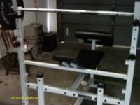 Weight bench with barbells, dumbbells, and free