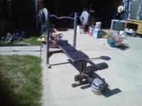For sale is a weight bench and weights with the bar