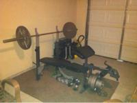 Weight bench in good condition with 45lb bar and 300