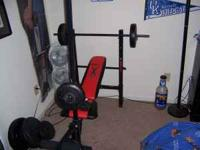 competitor weight bench w 130 lbs of weights included
