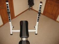 Weight bench with bar and two 25 pound, four 10 pound