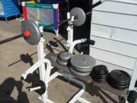 Weider 148 weight bench with bar and 216 lbs of free