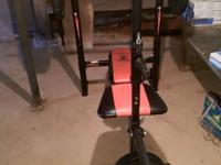 Weight bench with 80 lbs weights, missing the right bar