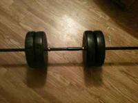 Up for sale is a weight lifting bar with weights. It