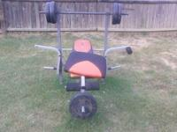 Weight Lifting Bench with a few weights and