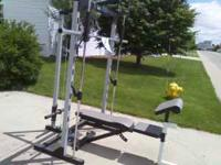 Weight Machine, Bench and 125 Lbs. of Steel Plates.
