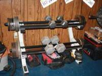 Brand new weight rack. Holds dumb bells and olympic