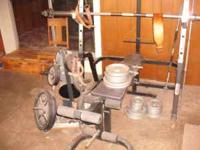 Olympic weight set. Includes bench, rack, bars, weight