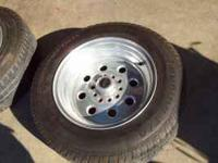 TWO GOOD WELD WHEEL 15X8 AND TIRES -205-70-15.. JAMES