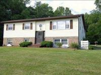Well kept Raised Ranch rental home on 3.4 acres of