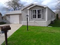WELL MAINTAINED ENERGY EFFICIENT MOBILE HOME. EXTERIOR