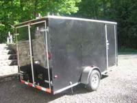 2007 Wells Cargo Model TC6121 enclosed trailer. Single