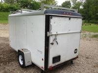 Wells cargo 6 x 12 Enclosed Trailer. Has ramp door and