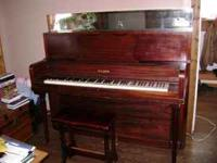 Weser upright piano w/bench. Needs tuning and a little